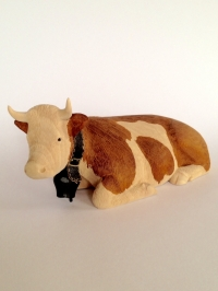 Simmentaler Kuh liegend